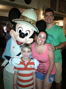 The Hartsell Family at Disneyland with Mickey Mouse.
