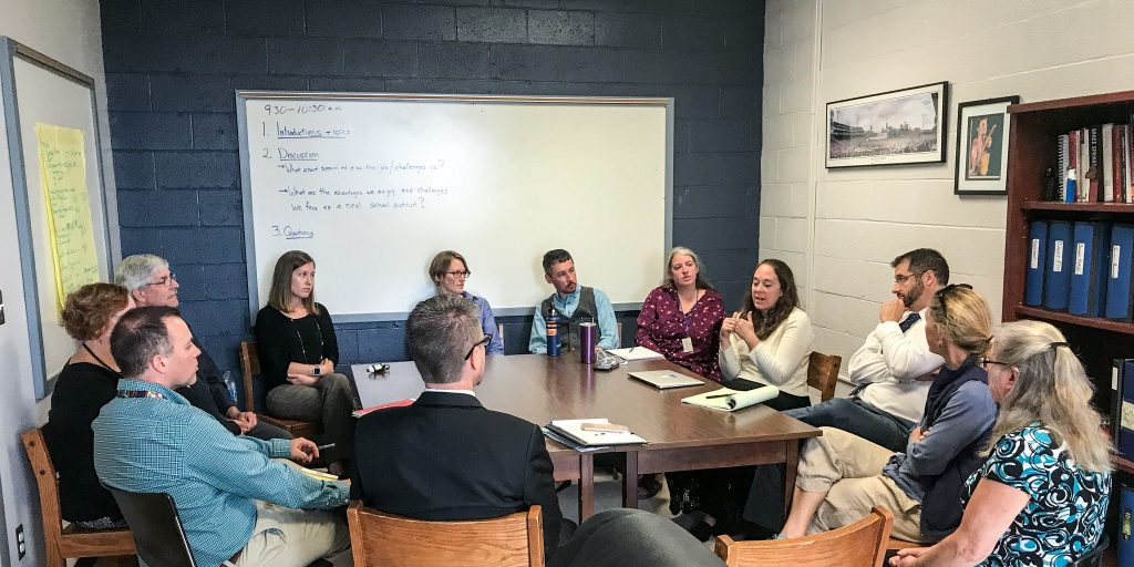 Johnny Collett and Kim Richey meeting with teachers, administrators, a parent and a board member at St. George Municipal School Unit.