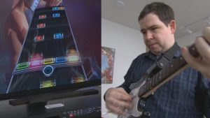 Christopher Pauley plays Rock Band video game.