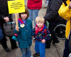 Emma Frome and Daniel Jarvis-Holland attending their first advocacy rally as small children