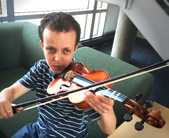 Daniel Bair Playing a Violin